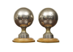 Pair of English polished metal newell posts on wooden bases