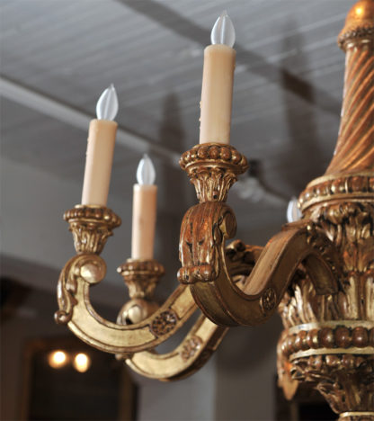 Elegantly carved eight light giltwood chandelier