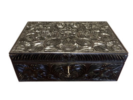 Ebony box with deep and intricate foliate carvings