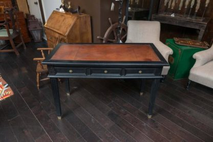 Garden Court Antiques, San Francisco - Ebonized three-drawer bureau plat with embossed leather top, French, circa 1880.