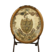 "Garden Court Antiques, San Francisco -""Arms of Aldridge"" Framed Stitchwork in Oval Giltwood Frame; English circa 1790"