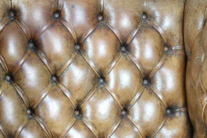 Garden Court Antiques, San Francisco -An Elegant Brown Tufted Leather and Mahogany Wing Chair with Tight Seat; English Circa 1860.