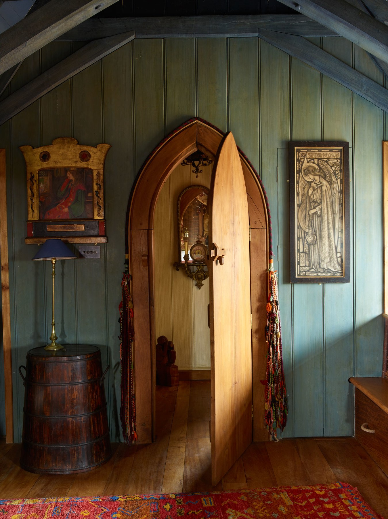The doorway of the master suite decorated with art and treasures from Irons's travels. Photo