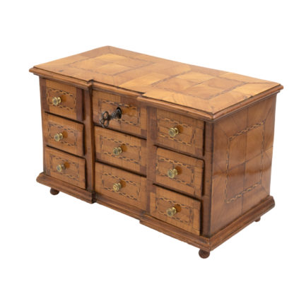 A Rare Miniature Fruitwood Inverted Break Center Chest Of Drawers With Checkered String Inlay. Unusual Central Locking Mechanism, German Circa 1780. Garden Court Antiques, San Francisco