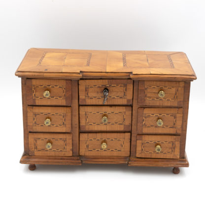 Front View: A Rare Miniature Fruitwood Inverted Break Center Chest Of Drawers With Checkered String Inlay. Unusual Central Locking Mechanism, German Circa 1780. Garden Court Antiques, San Francisco