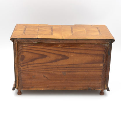 the back: A Rare Miniature Fruitwood Inverted Break Center Chest Of Drawers With Checkered String Inlay. Unusual Central Locking Mechanism, German Circa 1780. Garden Court Antiques, San Francisco