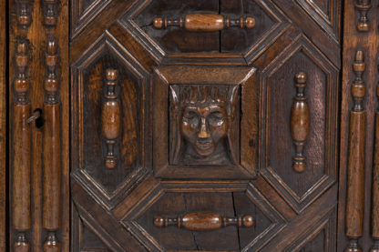 Late 17th/Early 18th Century Oak Cupboard Adorned With Decorative Geometric Mouldings And Split Spindle Appliqués.