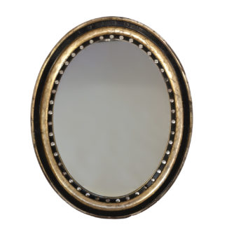 Irish Oval Mirror With Moulded Parcel-Gilded And Ebonized Frame, Applied With Mirrored Glass Facets, Circa 1890