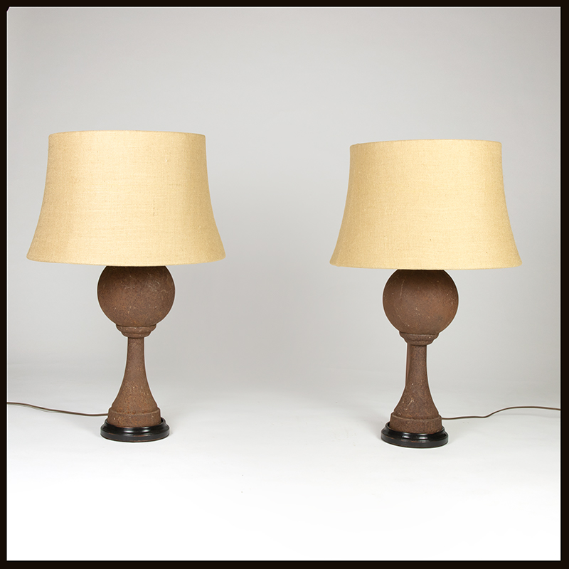 "Pair Of Iron Ball, ""boule"", chasse-roues mounted as table lamps, French, circa 1870."