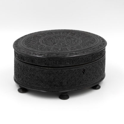 Anglo Indian Carved Solid Ebony Oval Box, Ceylon, Circa 1850.