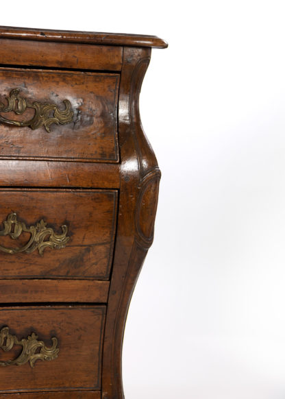 A Louis XV Provincial Walnut Bombe Commode, Mid-18th Century.