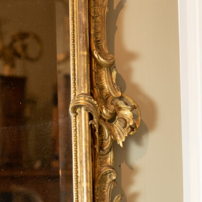 Long Ornately Carved French Giltwood Mirror Frame With Beveled Mercury Plate, Circa 1860.
