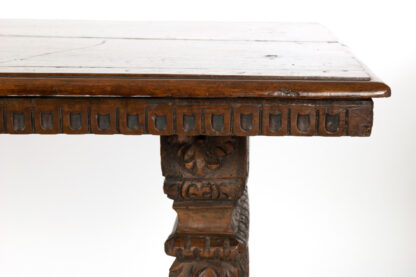 Italian Renaissance Revival Carved Walnut Trestle Library Table With Richly Carved Trestle Bases, Circa 1875.