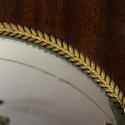 brass acanthus decoration on a Tiger Mahogany Convex Butler's Mirror With Brass Acanthus Leaf Slip And Brass Bee Motifs All Around, French Circa 1890