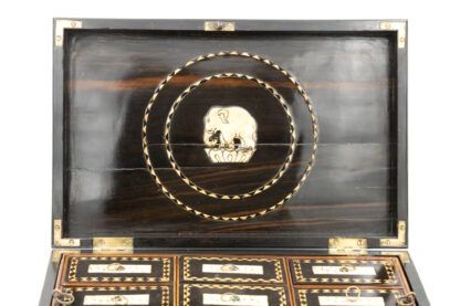 Central Medallion, Elephant, lid interior: Anglo Indian Coromandel Ebony Work Box Of Solid Ribbed Design With Fully Fitted Interior; Anglo-Indian, Circa 1860-1880.