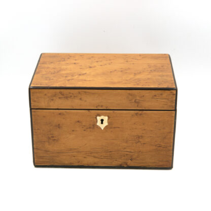 lined interior of a Choice Birds Eye Maple Box With Ebony Edging; English, Circa 1830-1850.
