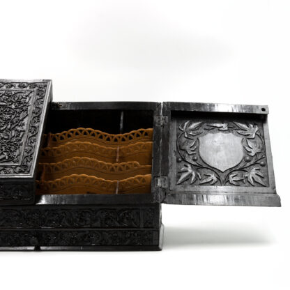 Shield decoration on a Impressive And Intricately Carved Solid Ebony Anglo-Indian Stationery Box, Circa 1850