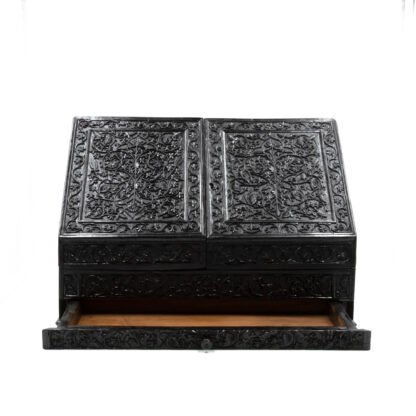 Opened bottom drawer: Impressive And Intricately Carved Solid Ebony Anglo-Indian Stationery Box, Circa 1850