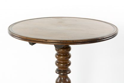 Top of a Circular French Fruitwood Tilt-Top Table With Turned Pedestal And Tripod Base, Circa 1860.