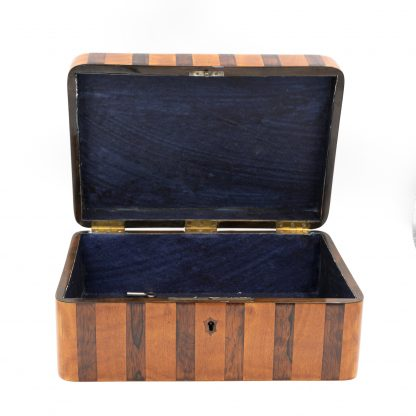 Paper lined interior of Satinwood And Coromandel Box With Radiating Starburst Pattern, Circa 1850.