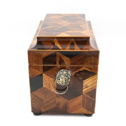 Side view of an Extraordinary Specimen Wood Tea Caddy With Both Tumbling Block And Vandyke Marquetry, English Circa 1810.