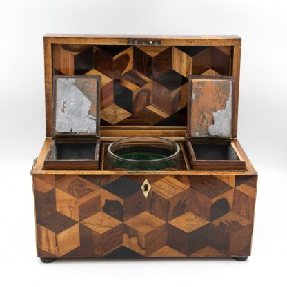 Interior of an Extraordinary Specimen Wood Tea Caddy With Both Tumbling Block And Vandyke Marquetry, English Circa 1810.