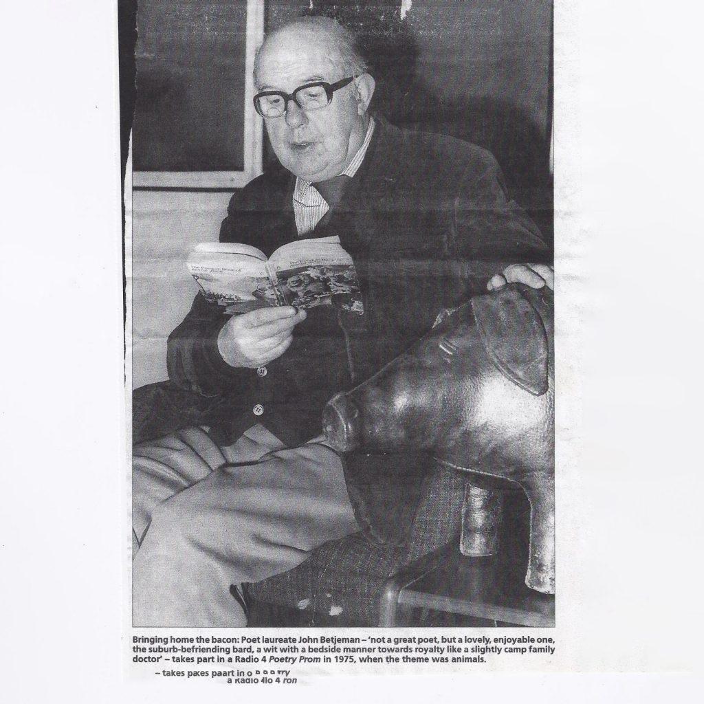 Sir John Betjeman, poet laureate, taking part in a Radio 4 Poetry Prom in 1975 with an Omersa pig.