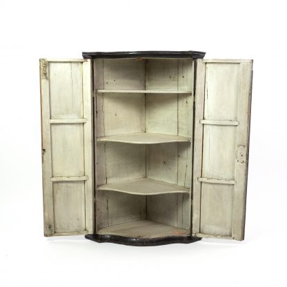 Interior of an Antique Black And Gold Chinoiserie Corner Cupboard With Painted Interior, English Circa 1820.