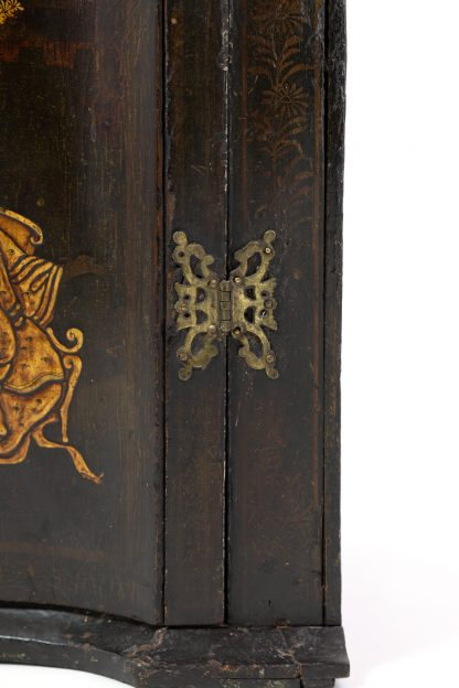 Corner detail of Antique Black And Gold Chinoiserie Corner Cupboard With Painted Interior, English Circa 1820.